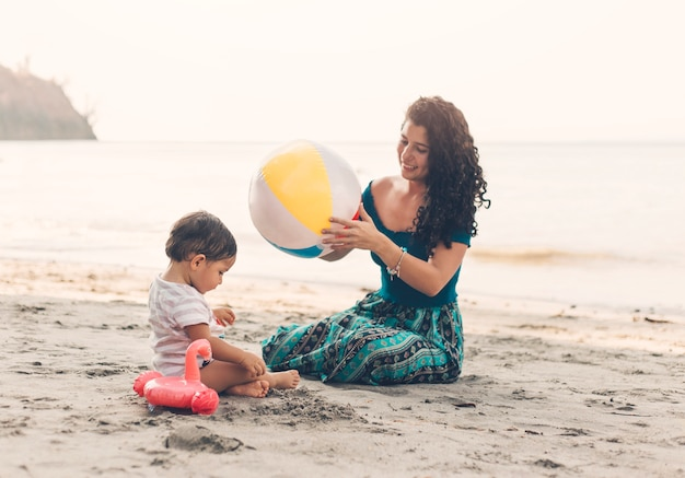 Woman with child on beach