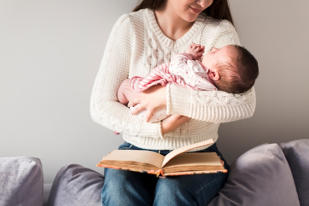 Woman with child and book