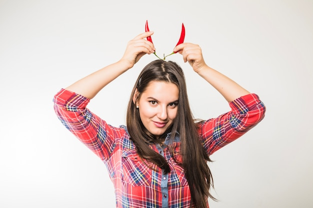 Woman with chili pepper devil horns