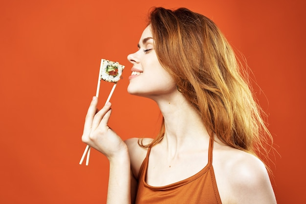 Woman with chopsticks sushi rolls japanese cuisine snack