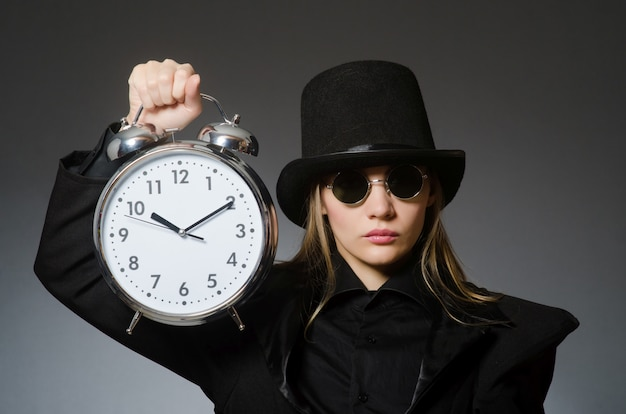 Woman with clock in business
