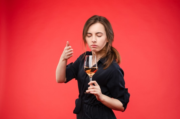 Woman with closed eyes smelling wineconcept of alcohol and scent.