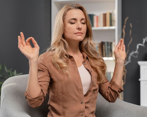 Woman with closed eyes trying to calm herself