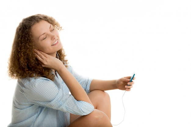 Woman with closed eyes while listening music