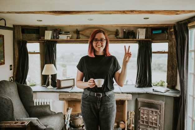 Woman with a coffee cup in a cabin