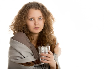 Woman with cold and a glass