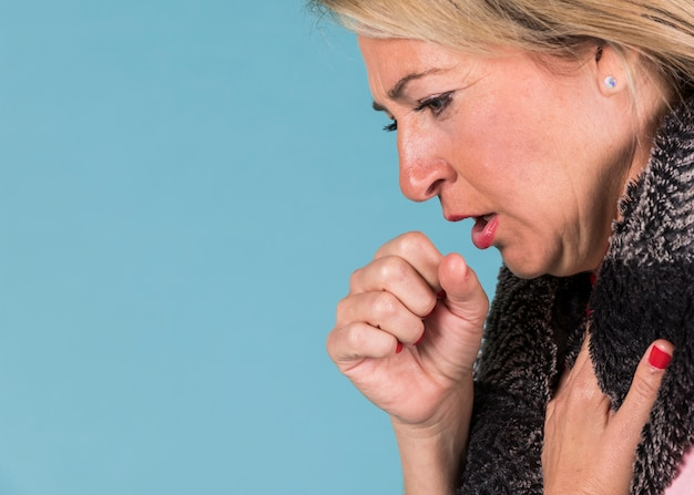 Woman with cough and sore throat feeling sick
