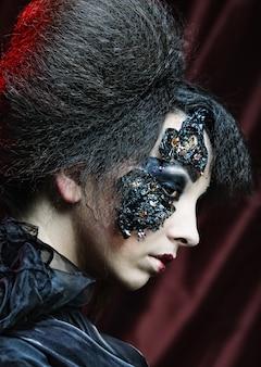 Woman with creative make up. halloween theme.