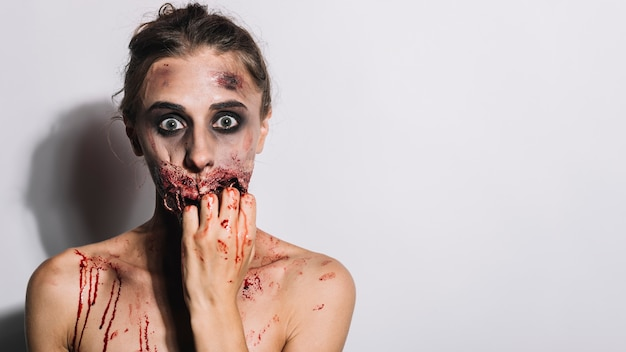 Woman with creepy stitched mouth