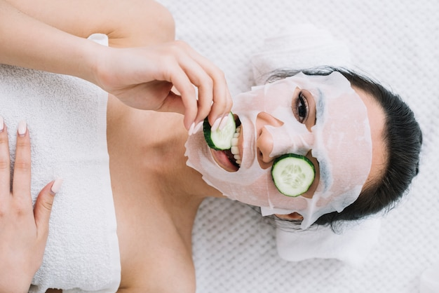 Woman with a cucumber mask