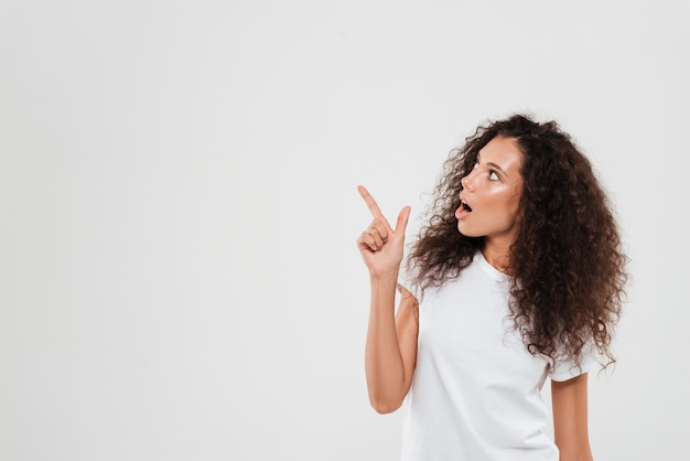 Woman with curly hair pointing finger away