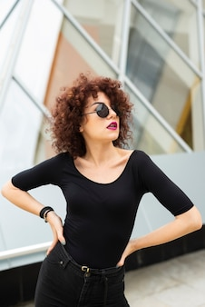 Woman with curly hair posing