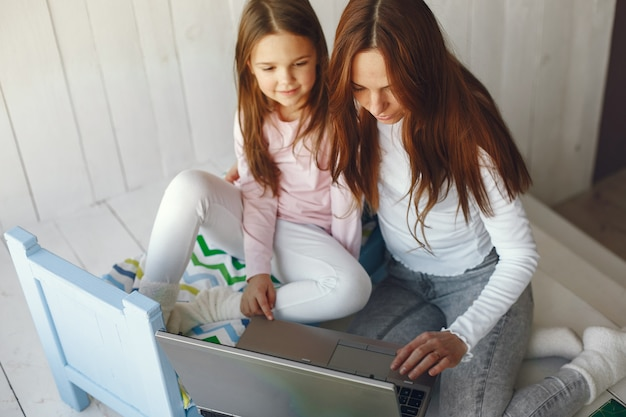 Woman with daughter using laptop computer