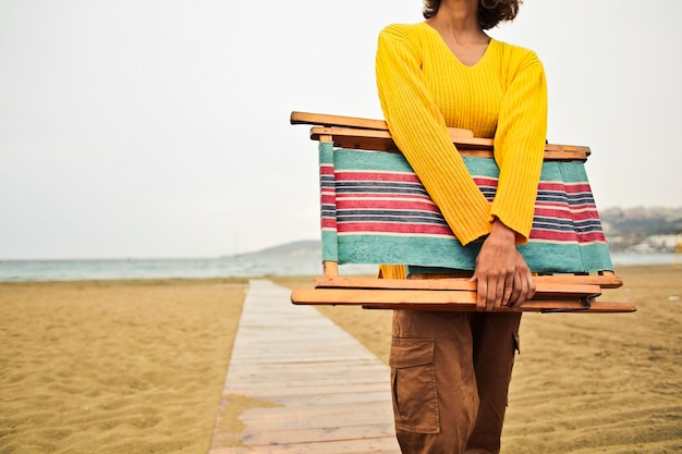 Woman with a deckchair