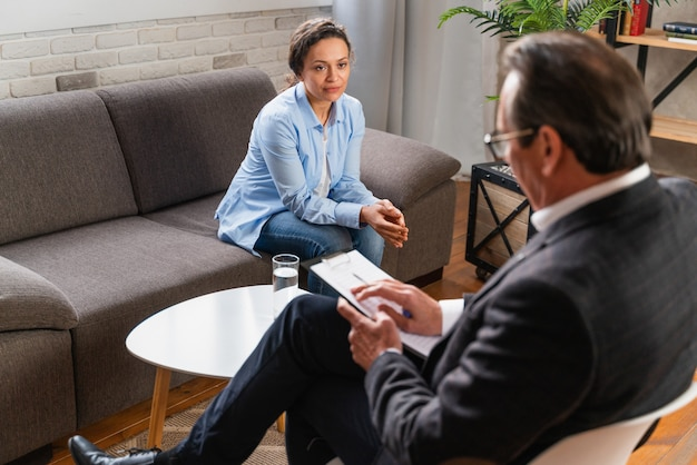 Woman with depression and relationship problems - psychoterapist studio, psychologist on a session with patient