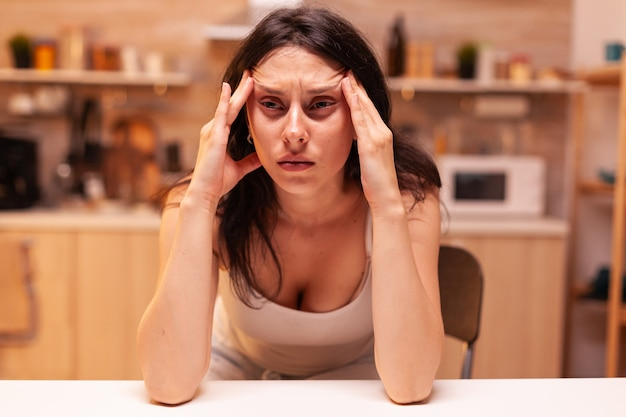 Woman with dizziness, stressed tired unhappy worried unwell wife suffering of migraine, depression, disease and anxiety feeling exhausted with allergy symptoms