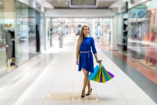 Woman with dollar and bags going shopping