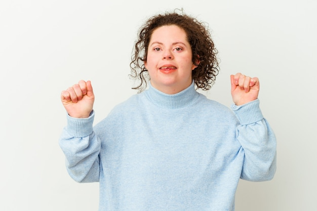 Woman with down syndrome isolated dancing and having fun.