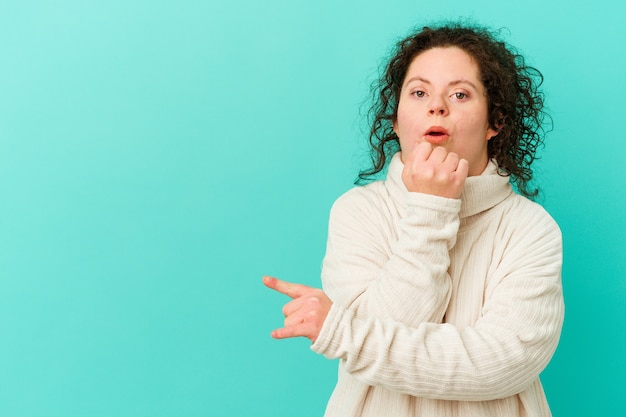 Woman with down syndrome isolated pointing to the side
