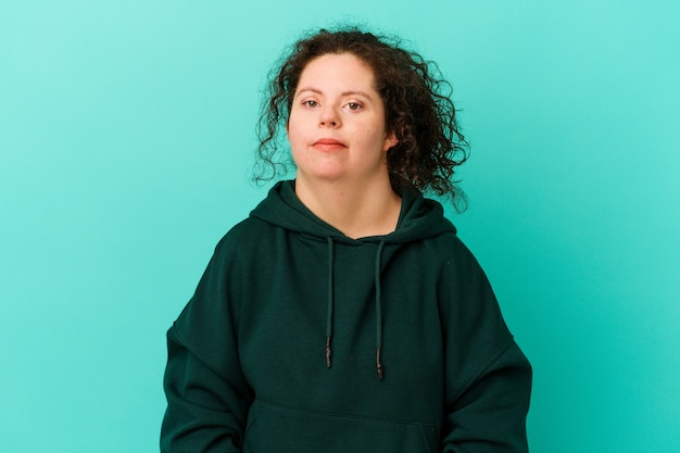 Woman with down syndrome isolated sad, serious face, feeling miserable and displeased.