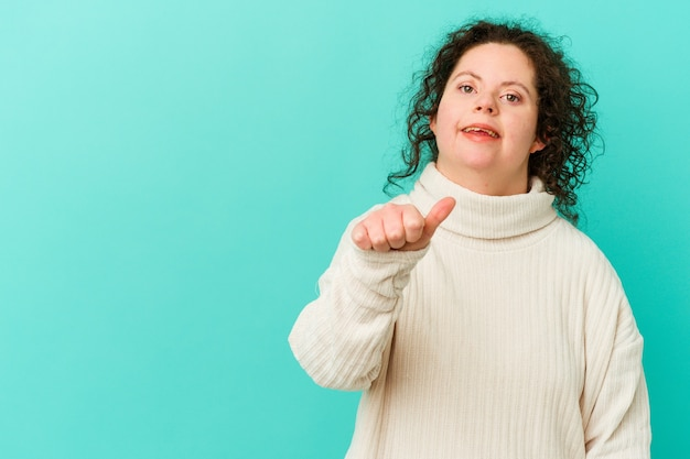 Woman with down syndrome isolated smiling and raising thumb up