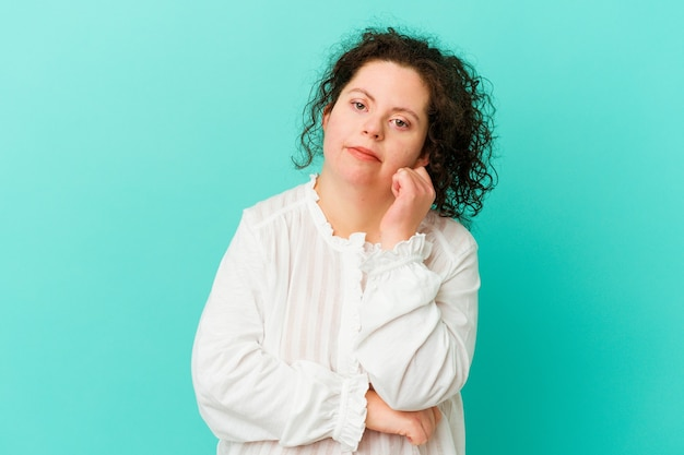 Woman with down syndrome isolated tired of a repetitive task.