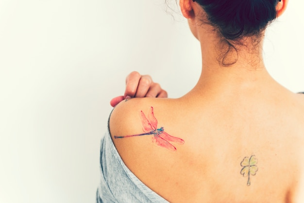 Woman with a dragonfly tattoo