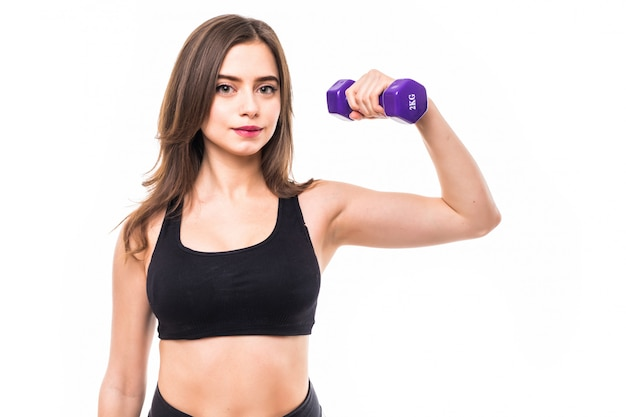 Woman with dumbbells working out and making different exercises for hands
