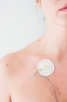 Woman with electrode on body