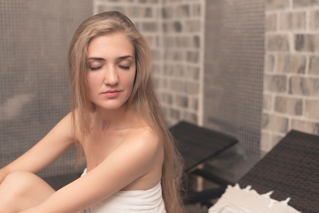 Woman with eye close relaxing in spa