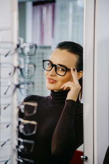 Woman with eyeglasses in optical store