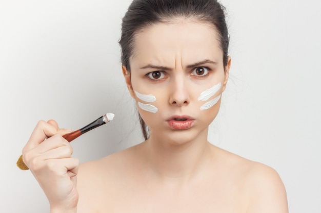 Woman with face cream mask skin care naked shoulders spa treatments.
