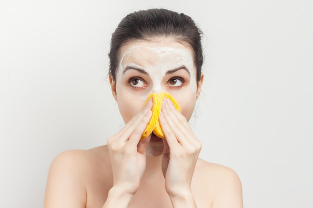 Woman with face mask doing skincare