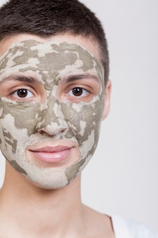 Woman with face mask looking at camera close-up