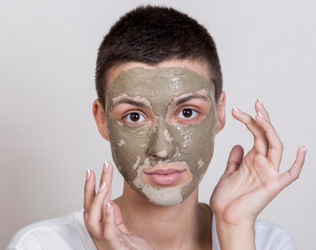 Woman with face mask looking at the camera