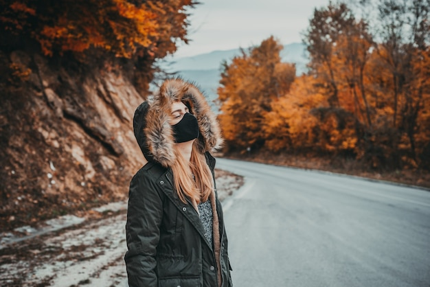 Woman with face mask outdoors