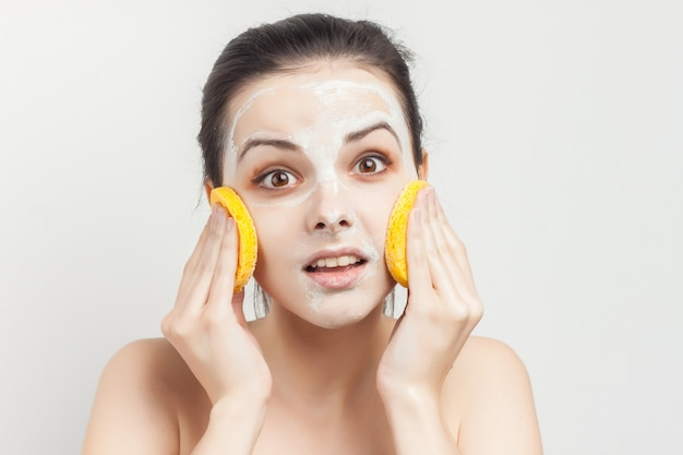 Woman with face mask and sponges