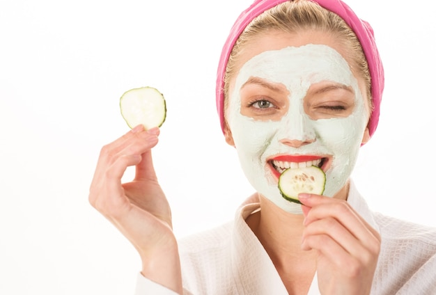 Woman with facial clay mask. spa salon. cosmetic mask with cucumber. natural beauty. perfect skin.