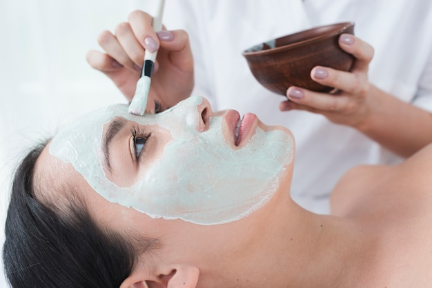 Woman with a facial mask in a spa