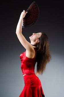 Woman with fan dancing dances