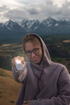 Woman with flashlight in summer altai mountains in kurai steppe