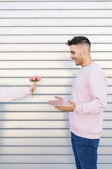Woman with flowers near happy man