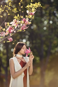 Woman with flowers outdoors