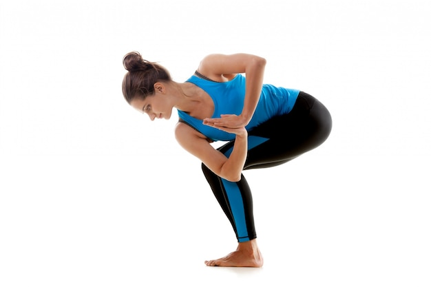Woman with folded hands stretching her buttock
