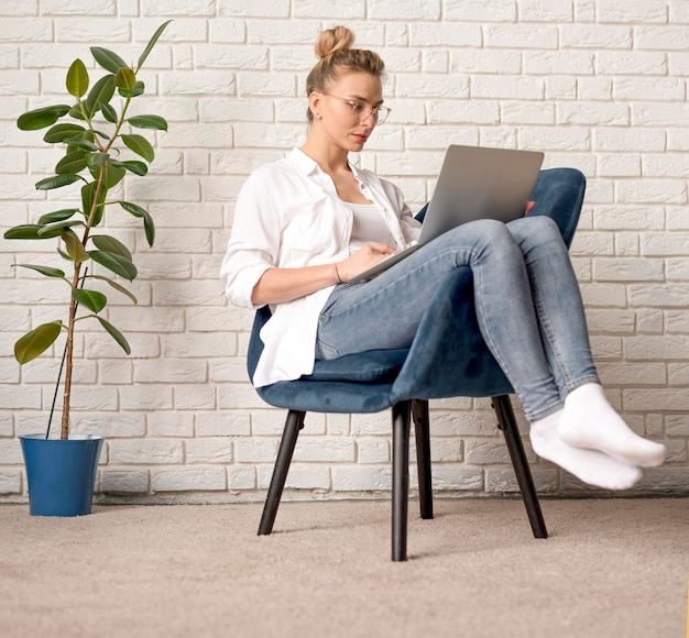 Woman with glasses on chair working