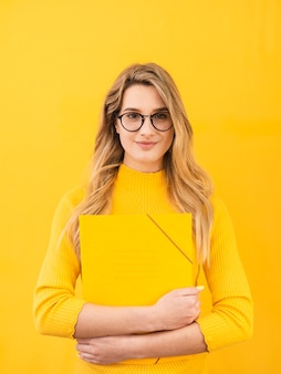 Woman with glasses and dossier
