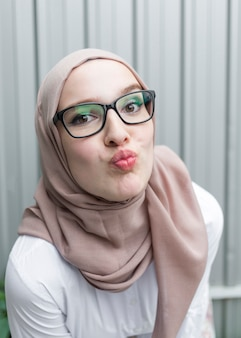 Woman with glasses and hijab