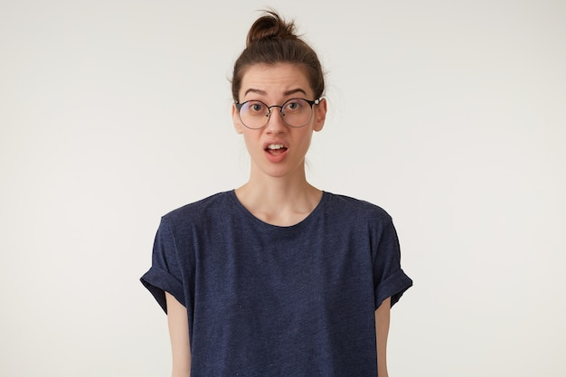 A woman with glasses swears, quarrels with a guy, a neighbor, looks inquiringly