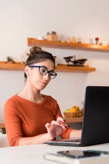 Woman with glasses working