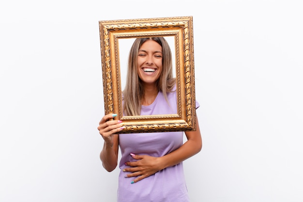 Woman with a golden frame, laughing